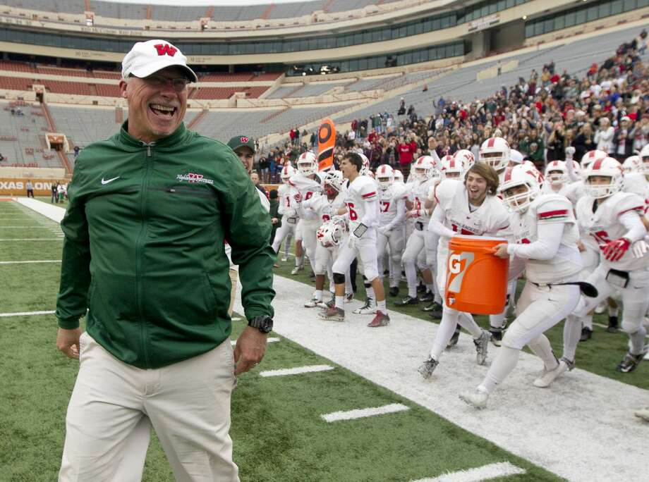 The Woodlands head coach Mark Schmid yells in celebration after the Highlanders knocked off Allen 36-28 in a Class 6A Division I state semifinal game at Darrell K Royal-Texas Memorial Stadium Saturday, Dec. 10, 2016, in Austin. Photo: Jason Fochtman/Houston Chronicle