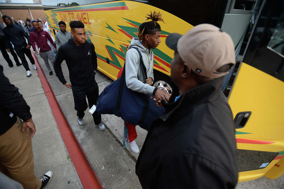 West Orange-Stark athletes board the bus Thursday headed to Dallas for the state playoffs. Photo taken Thursday, December 15, 2016 Guiseppe Barranco/The Enterprise Photo: Guiseppe Barranco, Guiseppe Barranco/The Enterprise