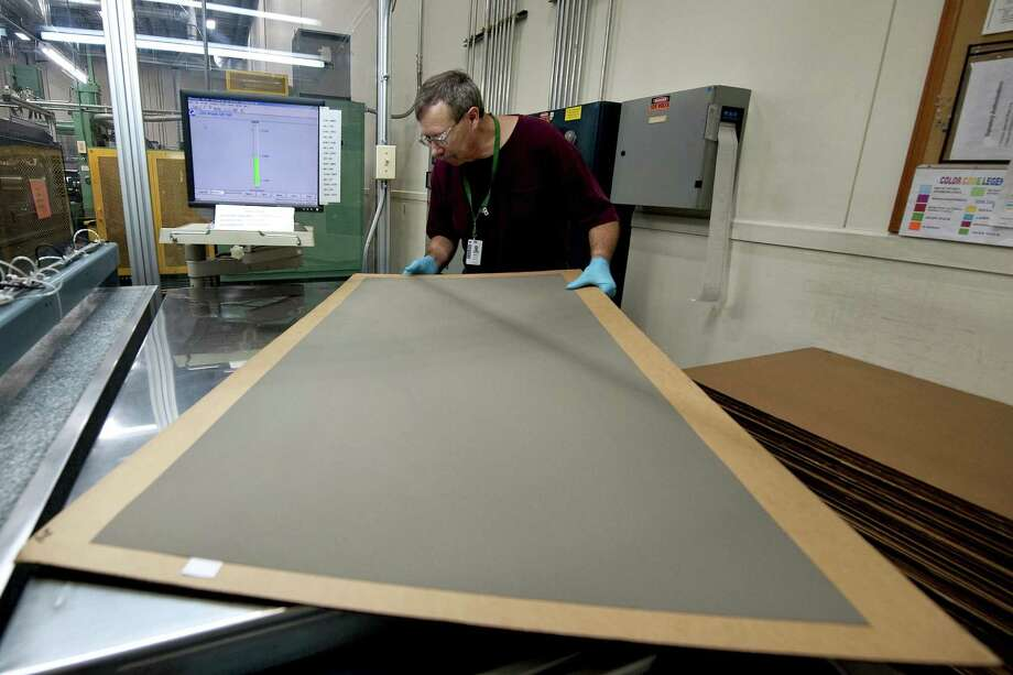 A Worker Prepares Components For Fuel Cell Inside The FuelCell Energy Manufacturing Facility In Torrington