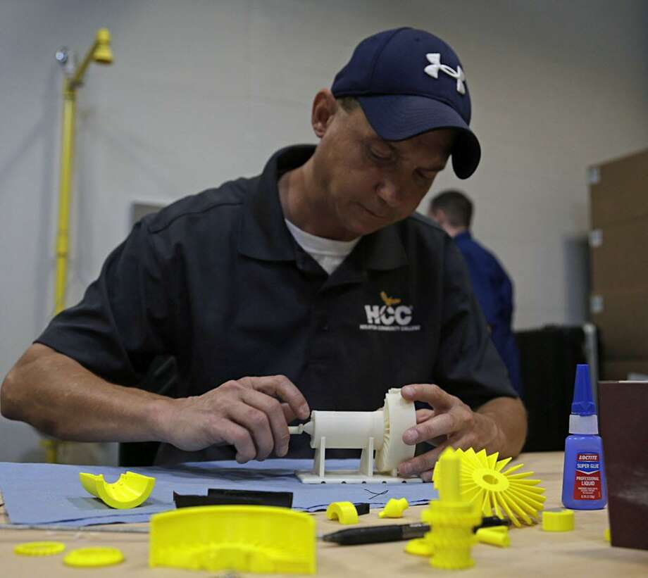 Houston Community College's Frederick Lemme works on a 3D printed jet turbine model at HCC's Advanced Manufacturing Center of Excellence Oct. 4, 2016, in Stafford. ( James Nielsen / Houston Chronicle ) Photo: James Nielsen / Houston Chronicle / © 2016  Houston Chronicle