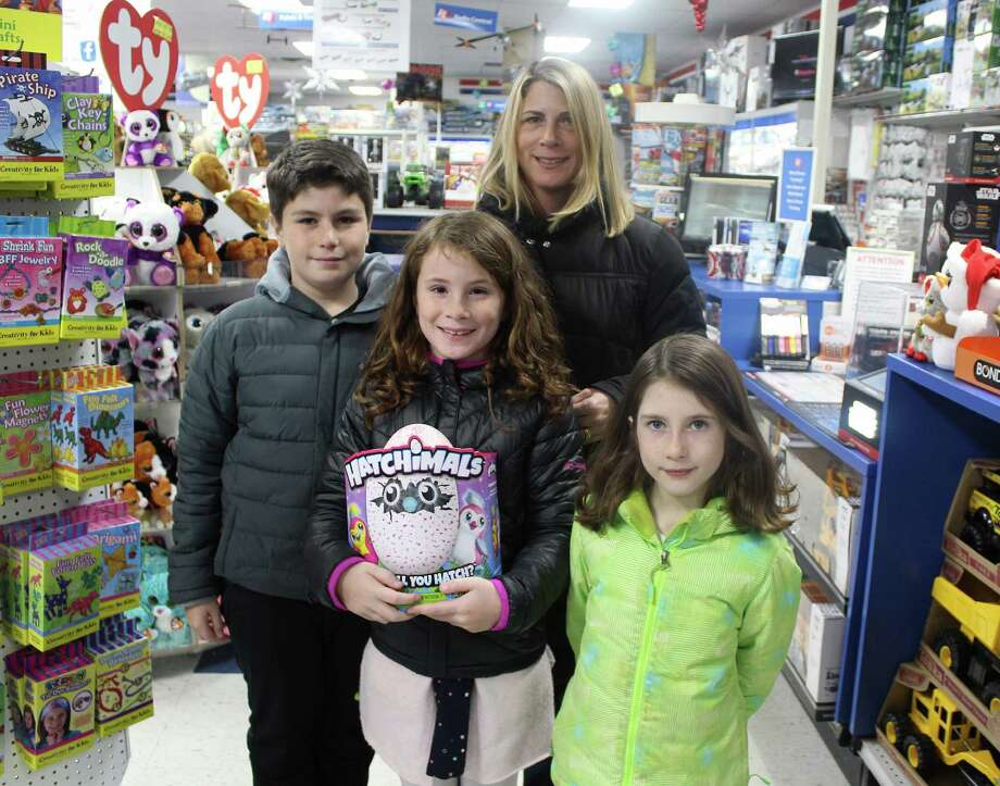 Gina Dignon smiles with children Ewan, 11, Addy, 9, and McKenna, 6, and their new Hatchimal on Dec. 14, 2016 at HobbyTown USA in Fairfield, Conn. The family won the sought-after toy in a holiday raffle from the local store. Photo: Laura Weiss / Hearst Connecticut Media / Fairfield Citizen