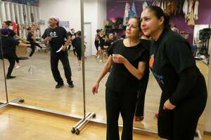 Dance Director Jeannette Chavez (right) and Belinda Menchaca, Director or Education at the Guadalupe Dance Academy, watch as the Folklorico I dance class rehearses for an upcoming performance at the Galeria Guadalupe, 723 S. Brazos, on Thursday, Nov. 17, 2016.  MARVIN PFEIFFER/ mpfeiffer@express-news.net