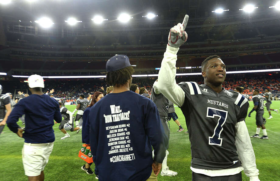 West Orange-Stark's players, including Malick Phillips, and coaches celebrate after defeating Celina 22-3 and earning the state championship during Friday's state finals game at NRG Stadium in Houston.   Photo taken Friday, December 18, 2015 Kim Brent/The Enterprise Photo: Kim Brent, Kim Brent/The Enterprise / Beaumont Enterprise