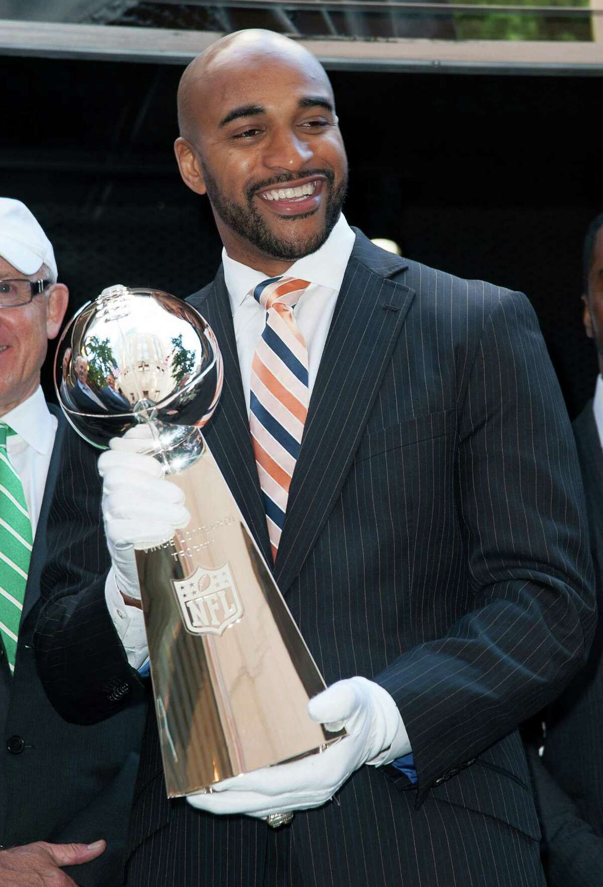 """NEW YORK, NY - SEPTEMBER 04: David Tyree carries the Vince Lombardi trophy during the """"Join The Huddle"""" Road To Super Bowl XLVIII Kick Off Mobile Tour at Tiffany & Co. on September 4, 2013 in New York City. (Photo by Dave Kotinsky/Getty Images)"""