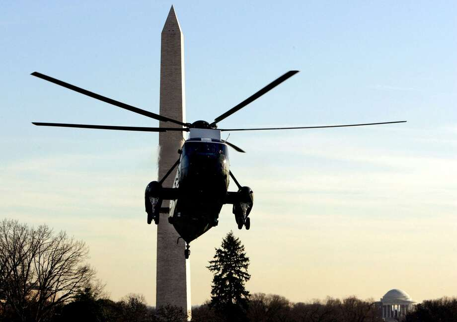 Marine One prepares to land on the South Lawn of the White House. Sikorsky and the Navy agreed in December on a new $138 million contract that will retain the maintenance program in Connecticut for VH-3D and VH-60N Marine One aircraft. Photo: File Photo / AP