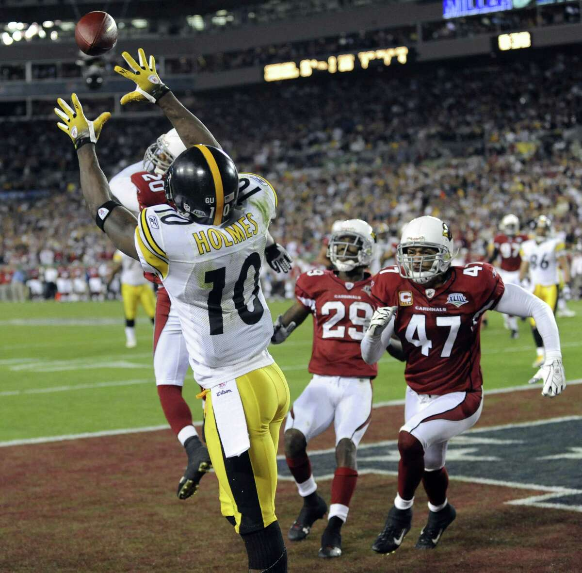 Santonio Holmes of the Pittsburgh Steelers catches a seven-yard touchdown pass with 35 seconds remaining for a 27-23 victory over the Arizona Cardinals in Super Bowl XLIII for a record sixth Super Bowl title on February 1, 2009 at Raymond James Stadium in Tampa, Florida. AFP PHOTO / TIMOTHY A. CLARY (Photo credit should read TIMOTHY A. CLARY/AFP/Getty Images)