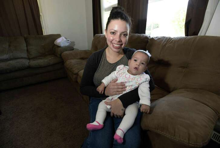 Estefani Montiel with her daughter Heidy, who was born at only 24 weeks of age, in their home on Monday, Nov. 14, 2016 in Charlotte, N.C. Montiel has registered the baby for the Salvation Army Christmas program. (David T. Foster III/The Charlotte Observer/TNS)