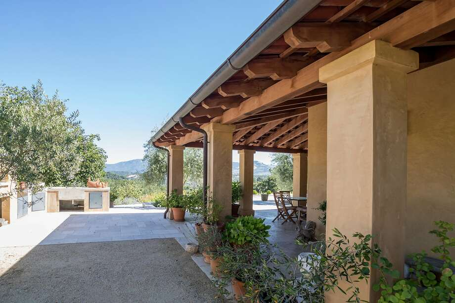 A covered patio wraps around the Mediterranean estate. Photo: Lisa Rani
