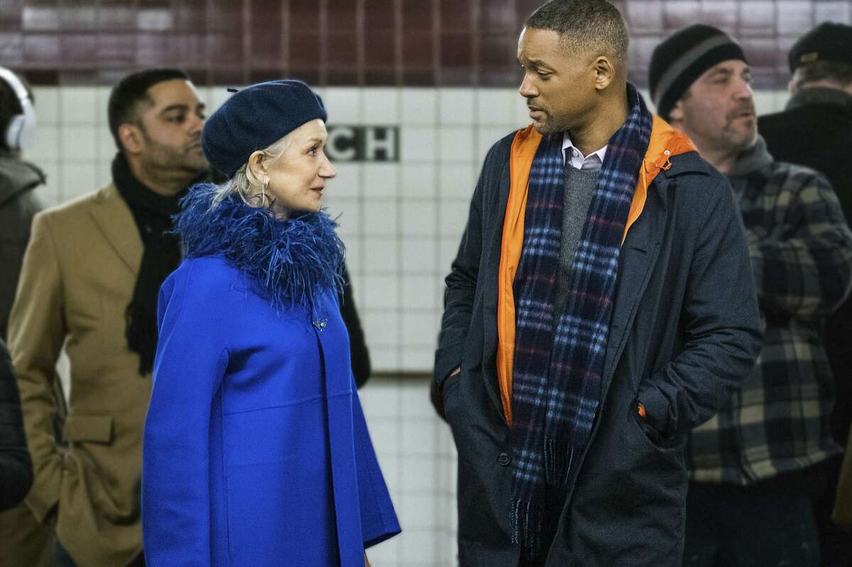 This image released by Warner Bros. Pictures shows Will Smith, right, and Helen Mirren in a scene from