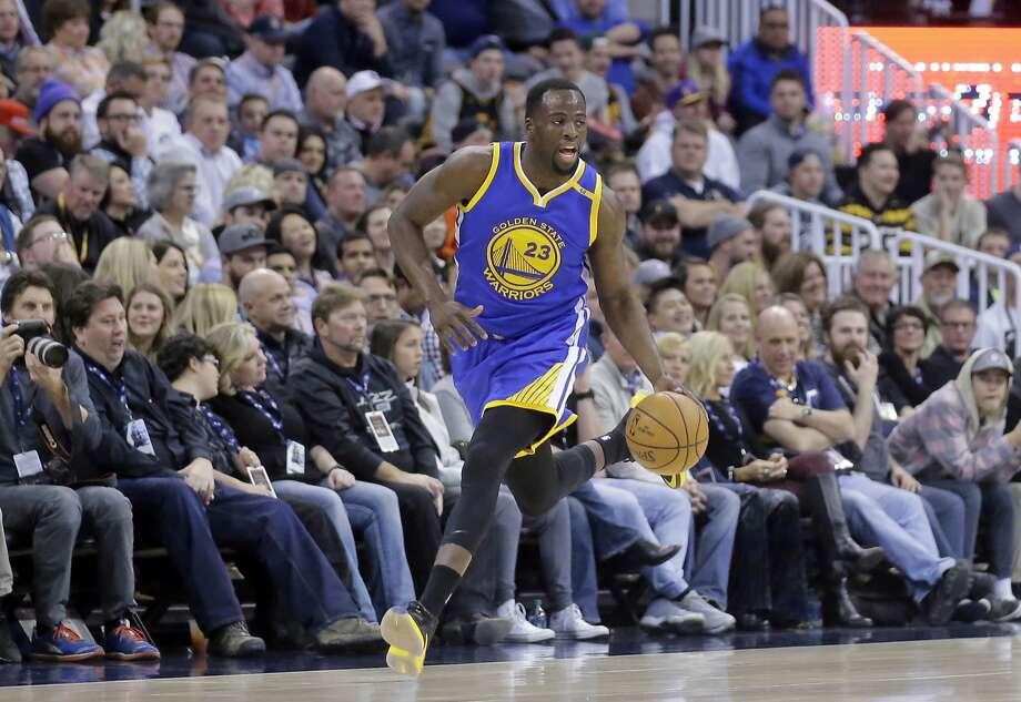 Golden State Warriors forward Draymond Green (23) drives against the Utah Jazz in the first half during an NBA basketball game Thursday, Dec. 8, 2016, in Salt Lake City. (AP Photo/Rick Bowmer) Photo: Rick Bowmer, Associated Press