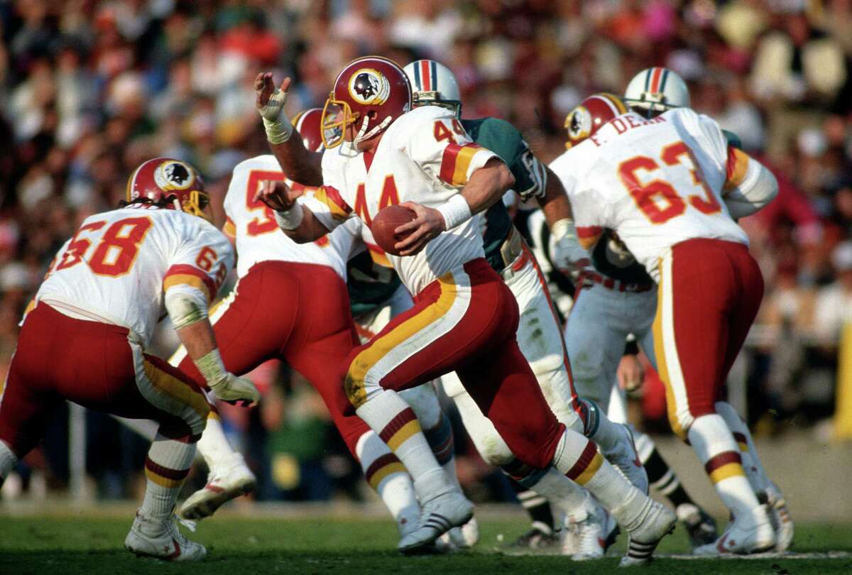 John Riggins #44 of the Washington Redskins carries the ball against the Miami Dolphins during Super Bowl XVII on January 30, 1983 at the Rose Bowl in Pasadena, California. The Redskins won the Super Bowl 27-17. (Photo by Focus on Sport/Getty Images)