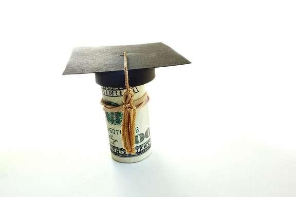 Mini graduation cap on a roll of cash
