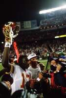 SAN DIEGO, CA- JANUARY 31:  Doug Williams #17 of the Washington Redskins walks off the field holding his helmet in the air after the Redskins defeated the Denver Broncos in Super Bowl XXII on January 31, 1988 at Jack Murphy Stadium in San Diego, California. The Redskins  won the Super Bowl 42-10. (Photo by Focus on Sport/Getty Images)
