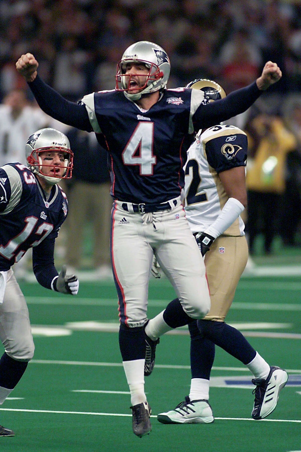 NEW ORLEANS, UNITED STATES: New England Patriots' kicker Adam Vinatieri (4) celebrates his game winning field goal in the second half 03 February, 2002 at Super Bowl XXXVI in New Orleans, Louisiana. The Patriots defeated the St. Louis Rams 20-17 for the NFL championship. AFP PHOTO/Timothy A. CLARY (Photo credit should read TIMOTHY A. CLARY/AFP/Getty Images)