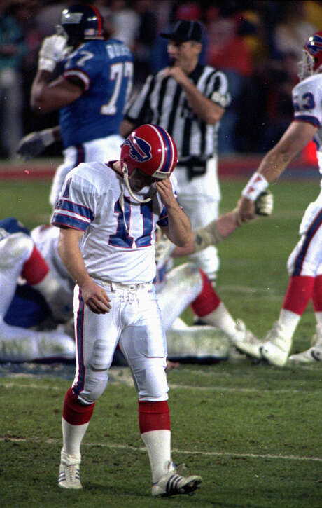 FILE- In this Jan. 27, 1991, file photo, Buffalo Bills' Scott Norwood walks off the field after missing what would have been the game-winning field goal in the NFL football Super Bowl XXV against the New York Giants in Tampa. The Giants won 20-19. (AP Photo/Chris O'Meara, File)