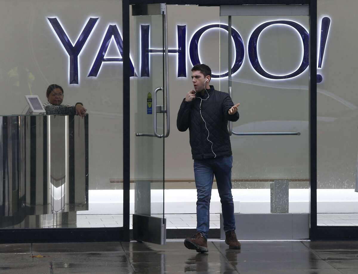 A man leaves the Yahoo office building on Fifth Street in San Francisco, Calif. on Thursday, Dec. 15, 2016. The tech giant revealed that a data breach in August 2013 may affect the personal information of as many as 1 billion users.