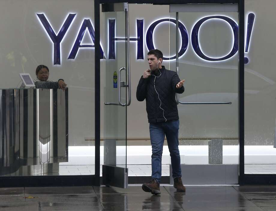 A man leaves the Yahoo office building on Fifth Street in San Francisco,The tech giant revealed that a data breach in August 2013 may have revealed the personal information of more than 1 billion users. Photo: Paul Chinn, The Chronicle