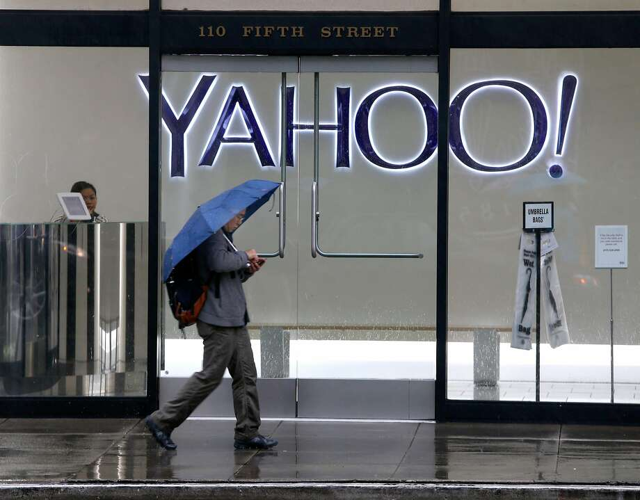 A man uses his smartphone while walking past Yahoo offices on Fifth Street in San Francisco, Calif. on Thursday, Dec. 15, 2016. The tech giant revealed that a data breach in August 2013 may affect the personal information of as many as 1 billion users. Photo: Paul Chinn, The Chronicle