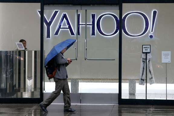 A man uses his smartphone while walking past Yahoo offices on Fifth Street in San Francisco, Calif. on Thursday, Dec. 15, 2016. The tech giant revealed that a data breach in August 2013 may affect the personal information of as many as 1 billion users.