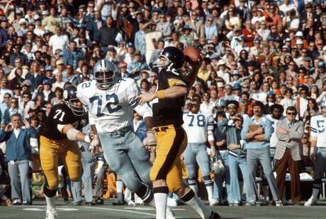 The Cowboys got their hits on Steelers quarterback Terry Bradshaw, but it wasn't enough to keep him from delivering the knockout  with a 64-yard touchdown pass to Lynn Swann.