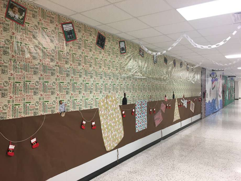 Pearland High School went all out for the holidays this year. Teachers took the school's new hallway decorating contest seriously, and the school had a Santa come to take photos with students. Photo: Pearland High School
