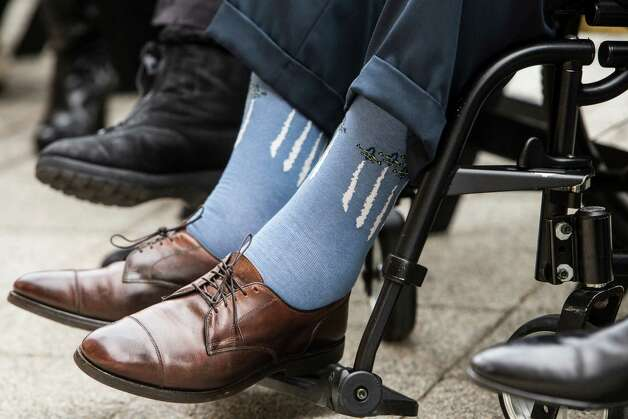 Former President George H.W. Bush wear aircraft socks while attending the 75th Anniversary ceremony of the attack on Pearl Harbor at the Bush Presidential Library on Wednesday, Dec. 7, 2016, in College Station. ( Brett Coomer / Houston Chronicle ) Photo: Brett Coomer, Staff / © 2016 Houston Chronicle