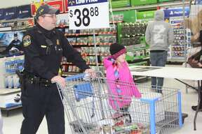 Local fire, EMS, police and other authorities roamed through Wal-Mart Wednesday afternoon with children from local elementary schools as part of Shop with a Hero.