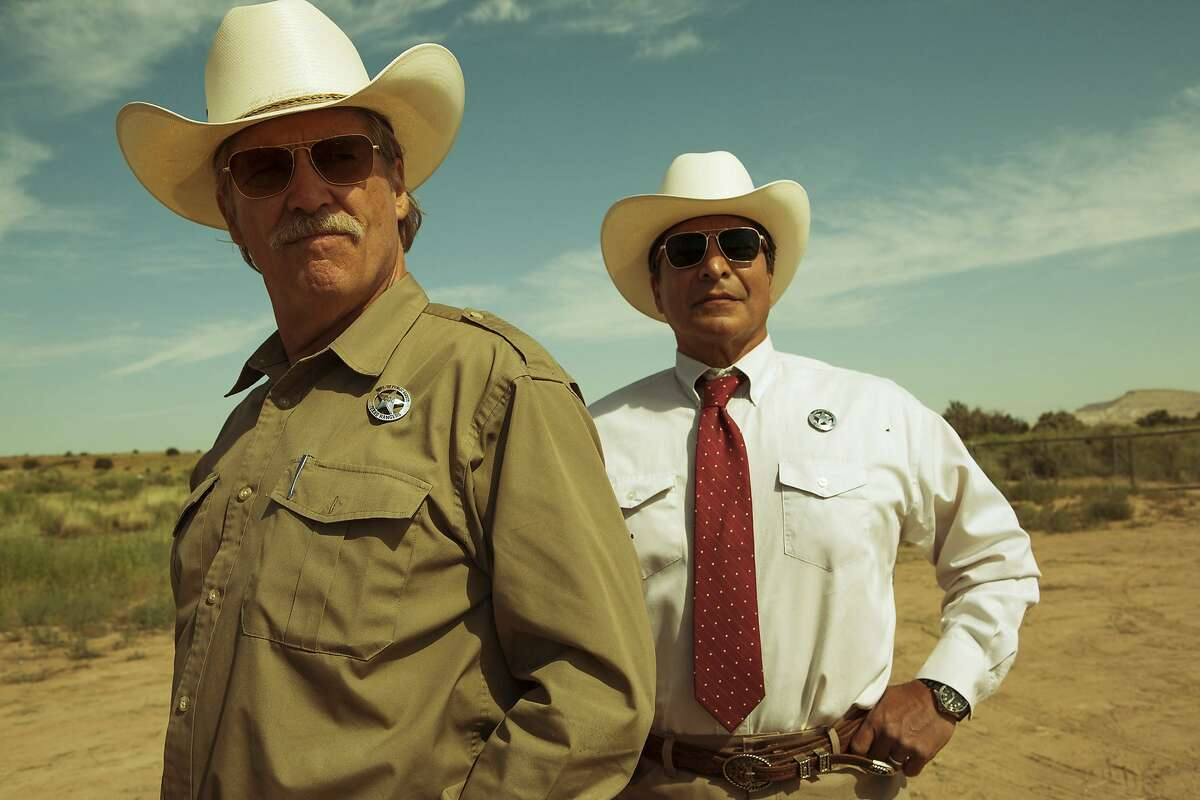"""This image released by CBS Films shows Jeff Bridges, left, and Gil Birmingham in a scene from """"Hell or High Water."""" Bridges was nominated for a Golden Globe award for best supporting actor for his role in the film on Monday, Dec. 12, 2016. The 74th Golden Globe Awards ceremony will be broadcast on Jan. 8, on NBC. (Lorey Sebastian/CBS Films via AP)"""