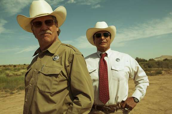 "This image released by CBS Films shows  Jeff Bridges, left, and Gil Birmingham in a scene from ""Hell or High Water."" Bridges was nominated for a Golden Globe award for best supporting actor for his role in the film on Monday, Dec. 12, 2016. The 74th Golden Globe Awards ceremony will be broadcast on Jan. 8, on NBC. (Lorey Sebastian/CBS Films via AP)"