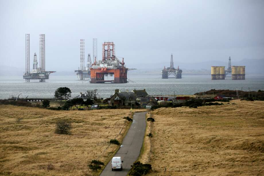 Bloomberg Best of the Year 2016: The West Phoenix oil platform, operated by Seadrill Norge AS, third left, stands with other unused platforms in the Port of Cromarty Firth in Cromarty, U.K., on Tuesday, Feb. 16, 2016. The pace of drilling in the North Sea, the center of U.K. oil production for the past 40 years, has sunk to a record as crashing energy prices force explorers to abandon costly projects. Photographer: Matthew Lloyd/Bloomberg Photo: Matthew Lloyd/Bloomberg