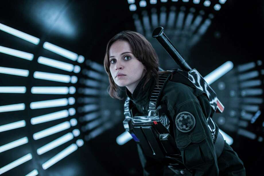 """This image released by Lucasfilm Ltd. shows Felicity Jones as Jyn Erso in a scene from, """"Rogue One: A Star Wars Story.""""  (Jonathan Olley/Lucasfilm Ltd. via AP) ORG XMIT: NYET751 Photo: Jonathan Olley / Copyright: 2015 Lucasfilm Ltd. & ™, All Rights Reserved."""