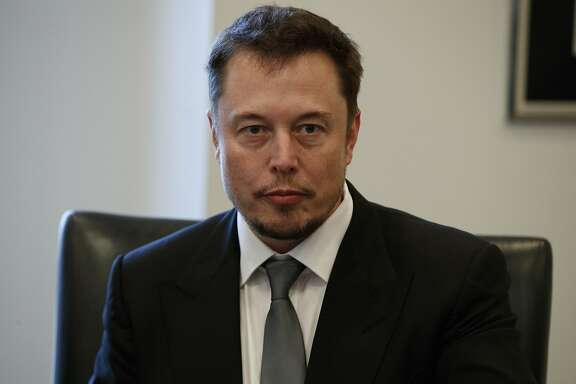 Tesla CEO Elon Musk listens as President-elect Donald Trump speaks during a meeting with technology industry leaders at Trump Tower in New York, Wednesday, Dec. 14, 2016. (AP Photo/Evan Vucci)