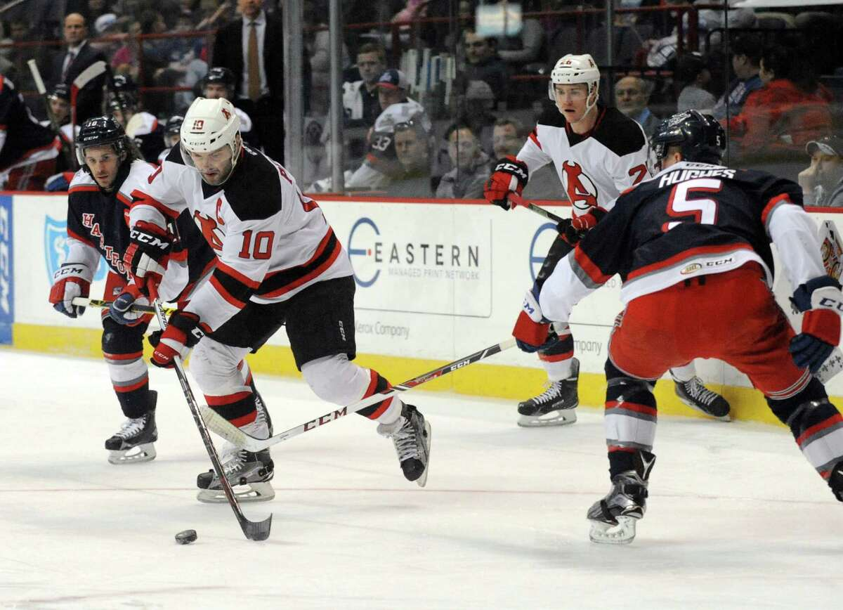 Albany Devil Rod Pelley looks to pass during their game against Hartford at the Times Union Center on Tuesday March 29, 2016 in Albany, N.Y. (Michael P. Farrell/Times Union) ORG XMIT: MER2016121514384353
