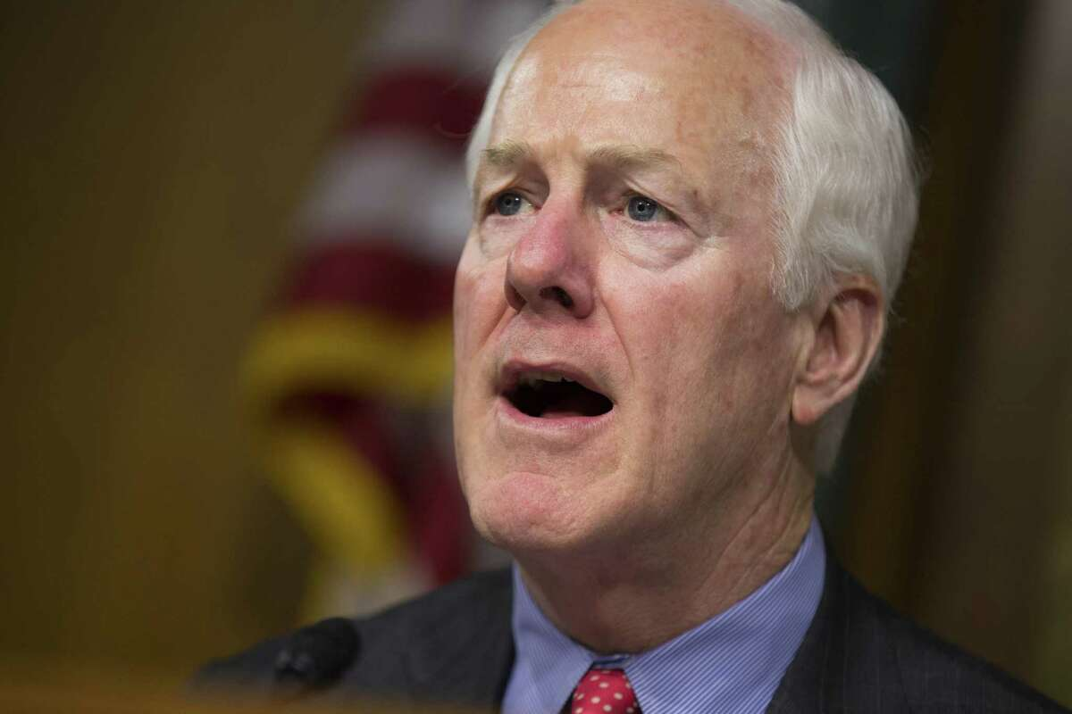 """FILE - In this June 7, 2016, file photo, Sen. John Cornyn, R-Texas speaks on Capitol Hill in Washington. Congressional Democrats are warning that Speaker Paul Ryan and President-elect Donald Trump are gunning for Medicare _ and they are rubbing their hands in glee at the prospect of an epic political battle over the government?'s flagship health program that covers 57 million Americans. It turns out that Republicans, especially in the Senate, are not spoiling for a fight. ?""""We are not inclined to lead with our chin,?"""" said Cornyn of Texas. ?""""And right now, we?'ve got a lot on our plate.?"""" (AP Photo/Evan Vucci, File)"""