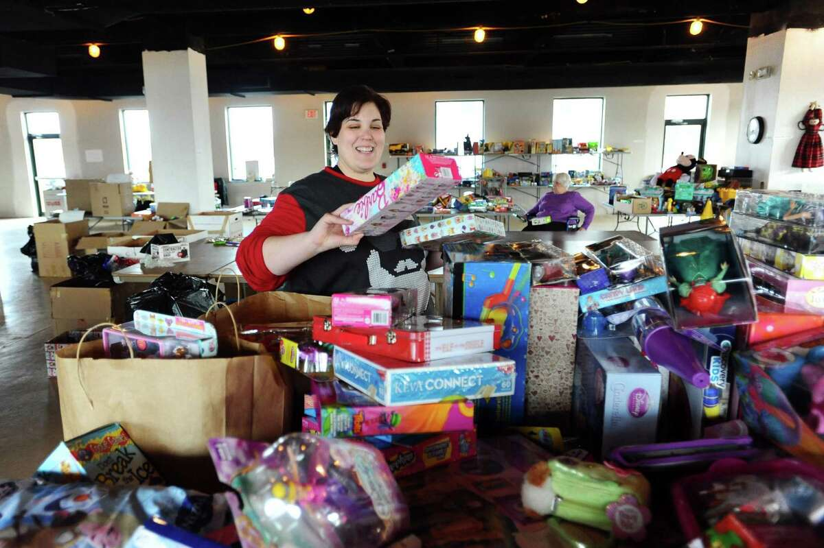 Amy Serino, of Stamford, finds age appropriate toys for a Christmas gift bag inside the temporary space for Toys for Tots on Canal St. in Stamford, Conn. on Thursday, Dec. 15, 2016. Toys for Tots in Stamford still needs 3,000 toys to meet the requests it received this Christmas.