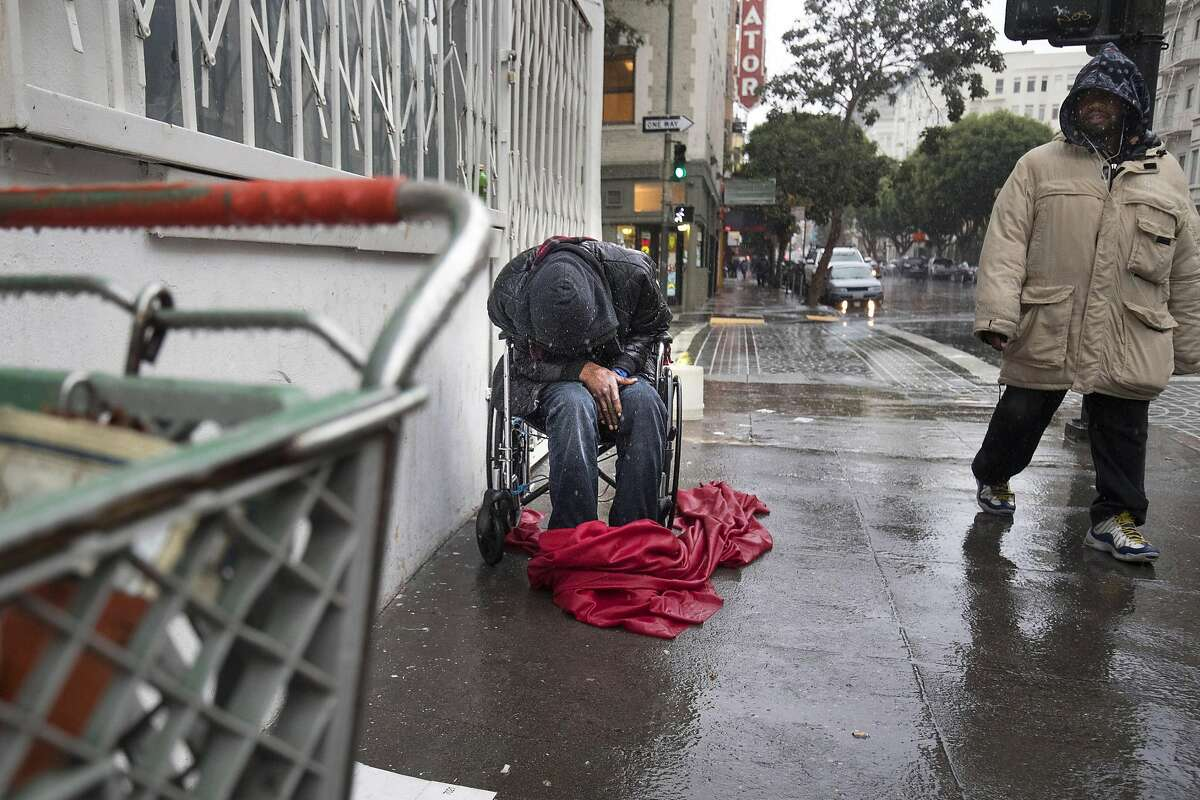 A homeless man sits in a wheelchair in the rain on Leavenworth St. in SF on Thursday, Dec. 15, 2016 in San Francisco, Leavenworth St. and Jones St. Green (Lundgren) Mayor Ed Lee and San Francisco judges are mutually furious with each other. The mayor claims the judges are abusing their authority by dismissing thousands of homeless citations, which he contends are part of a larger effort to address the needs of those on the streets. The judges in turn think the citations are part of a national problem of criminalizing the poor. And they think the mayor should stay in his lane.
