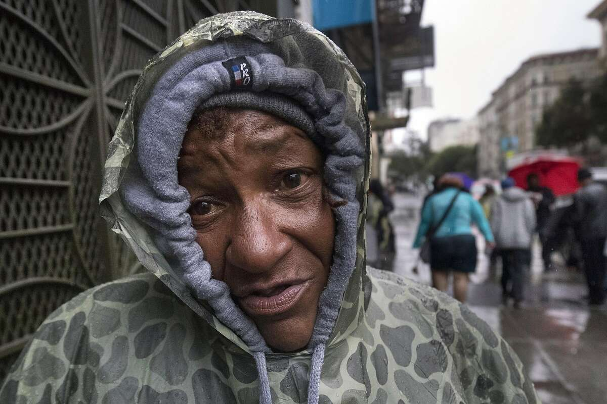 """Joy Love stands in the rain on Leavenworth St. near Jones St. on Thursday, Dec. 15, 2016 in San Francisco, Leavenworth St. and Jones St. She said she's been homeless for 25 years and receives 2 SFPD citations a month but knows they will be dismissed. """"I'm like a fish out of water and now gulping for my last breath. And Christmas is next week. It's so sad,"""" Love said. Green (Lundgren) Mayor Ed Lee and San Francisco judges are mutually furious with each other. The mayor claims the judges are abusing their authority by dismissing thousands of homeless citations, which he contends are part of a larger effort to address the needs of those on the streets. The judges in turn think the citations are part of a national problem of criminalizing the poor. And they think the mayor should stay in his lane."""