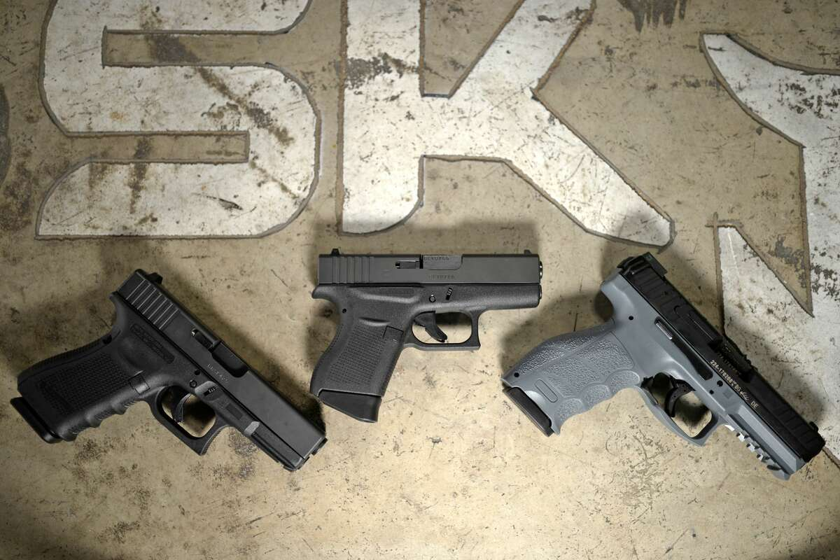 Top gift items from SK Arms - from left, Glock 19, Glock 43, Heckler & Koch VP9, photographed Thursday, Dec. 15, 2016, at SK Arms. James Durbin/Reporter-Telegram
