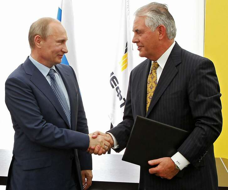 FILE- In this June 15, 2012, file photo, Russian President Vladimir Putin, left, and ExxonMobil CEO Rex Tillerson, now secretary of state-designate, shake hands at a signing ceremony of an agreement between state-controlled Russian oil company Rosneft and ExxonMobil at the Black Sea port of Tuapse, southern Russia. If there's one thing Republicans and Democrats have agreed on in foreign policy, it is the power of sanctions. Both have levied economic penalties on foreign governments, pressuring Iran into nuclear concessions or Myanmar into democratic reform. But Donald Trump's choice for secretary of state has seen things differently.  (Mikhail Klimentyev/RIA-Novosti, Presidential Press Service via AP, Pool, File)