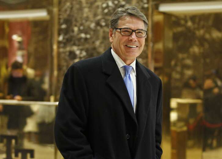 FILE - In this Dec. 12, 2016 file photo, Energy Secretary-designate, former Texas Gov. Rick Perry smiles as he leaves Trump Tower in New York. As President-elect Donald Trump fills out his Cabinet, it's looking less like America's population and more like the world Trump has always orbited, filled with rich white men and delivering on Trump's promise to ignore political correctness. (AP Photo/Kathy Willens, File)