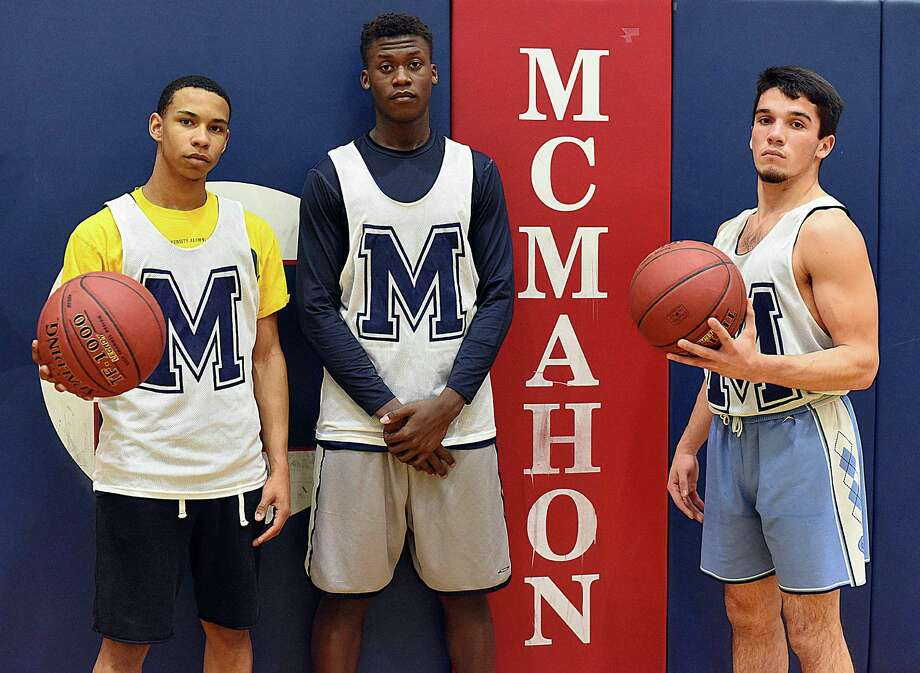 Brien McMahon boys varsity basketball captains from 2016-17 are, from left, Matt Saint Louis, Aaron McKeithan, and Brendan Quinlan-Huertas. Photo: John Nash / Hearst Connecticut Media / Norwalk Hour