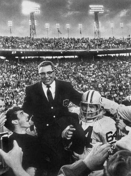 Green Bay Packers head coach Vince Lombardi is carried off the field by team members, including guard Jerry Kramer, right, after the Packers defeated the Oakland Raiders 33-14 in Super Bowl II, Jan. 14, 1968, in Miami. After winning the first two Super Bowls, Green Bay would not win the game again until 1997, but the Super Bowl trophy has been named the Vince Lombardi Trophy since the coaché­s death in 1970. (AP Photo)