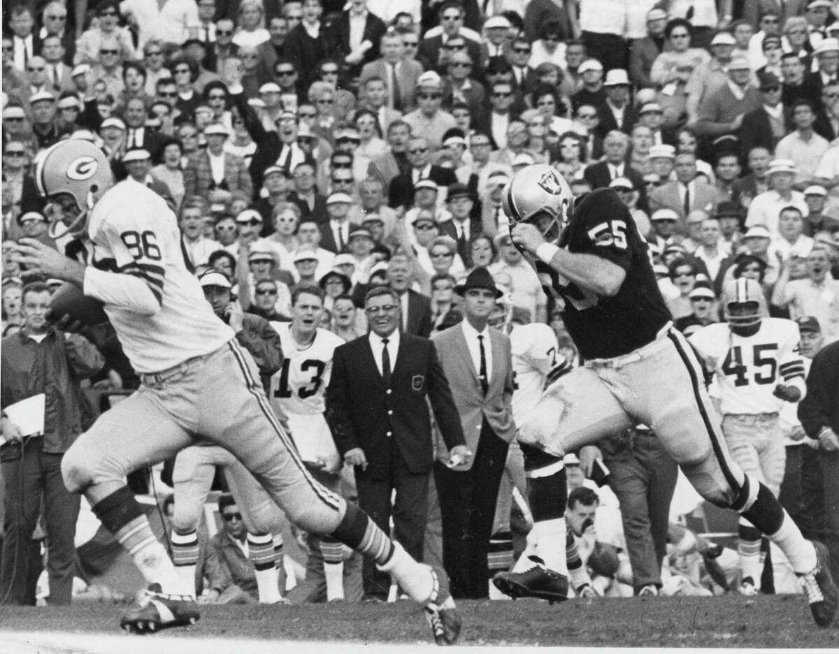 Packers coach Vince Lombardi could laugh on the sidelines as Boyd Dowler went 62 yards for a touchdown and helped Green Bay run past the Raiders 33-14 for a second consecutive championship.