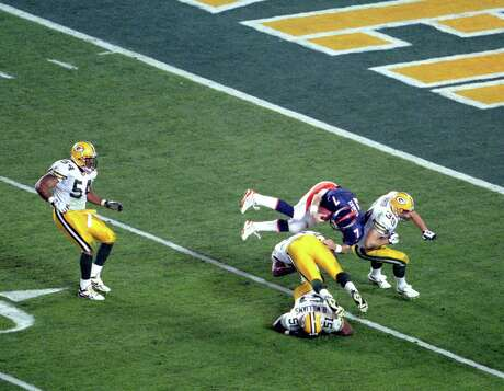 John Elway could celebrate his first Super Bowl and eventually lift the Lombardi Trophy after making plays like his diving scramble to set up a Denver touchdown.