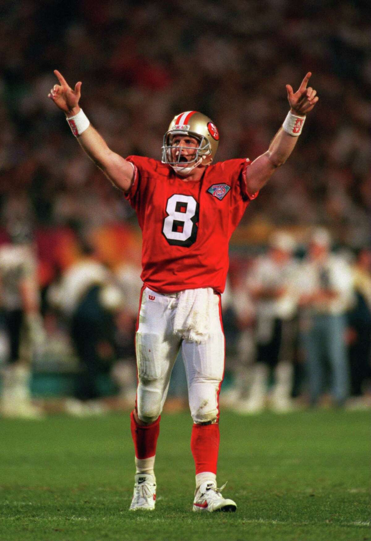29 Jan 1995: SAN FRANCISCO QUARTERBACK STEVE YOUNG CELEBRATES AFTER THROWING A 15 YARD TOUCHDOWN PASS TO JERRY RICE TO PUT THE 49ERS UP 42-10 DURING THE THIRD QUARTER OF THE SAN FRANCISCO 49ERS VERSUS SAN DIEGO CHARGERS IN SUPER BOWL XXIX AT JOE ROBBIE ST