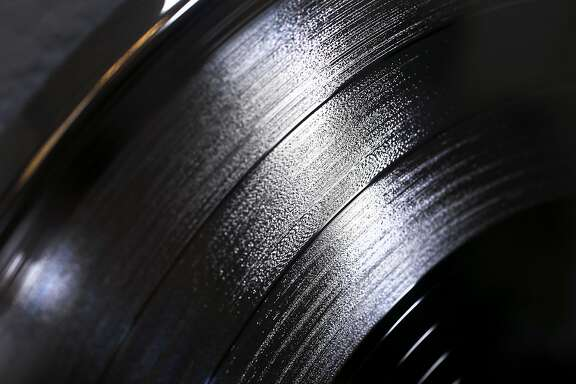 Grooves are etched into a master copy of a record album displayed at the Pirates Press vinyl record manufacturing company in Emeryville, Calif. on Thursday, Dec. 15, 2016.