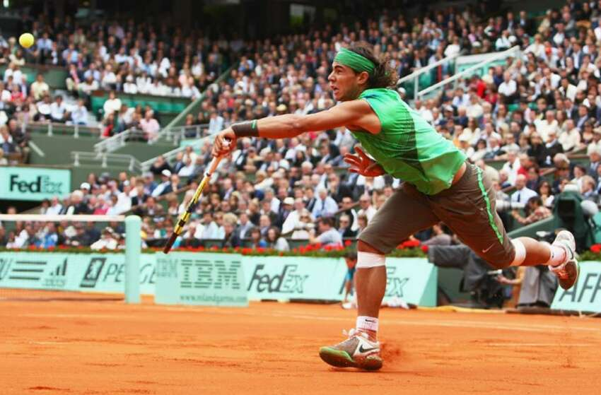 PARIS - JUNE 06: Rafael Nadal of Spain hits a forehand during the Men's Singles Semi Final match against Novak Djokovic of Serbia on day thirteen of the French Open at Roland Garros on June 6, 2008 in Paris, France. (Photo by Mike Hewitt/Getty Images)