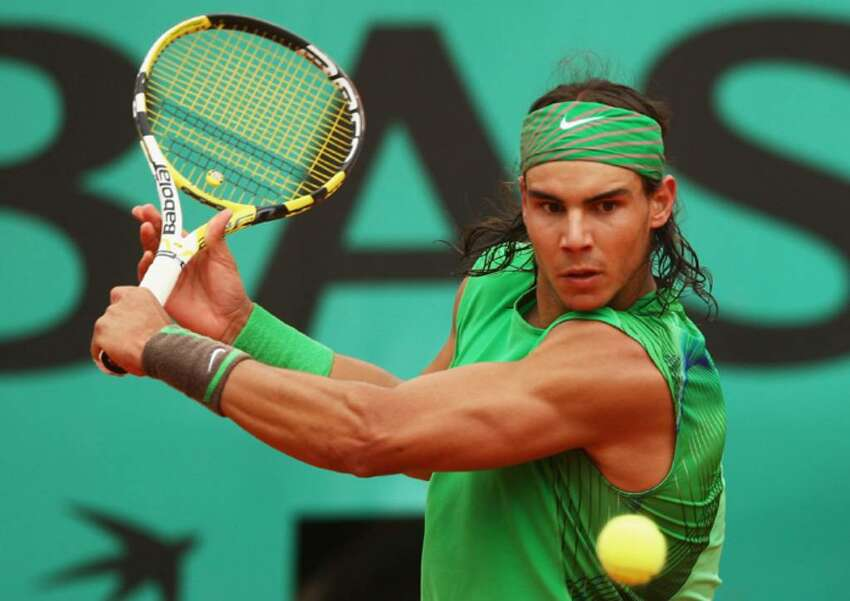 PARIS - JUNE 06: Rafael Nadal of Spain hits a backhand during the Men's Singles Semi Final match against Novak Djokovic of Serbia on day thirteen of the French Open at Roland Garros on June 6, 2008 in Paris, France. (Photo by Mike Hewitt/Getty Images)