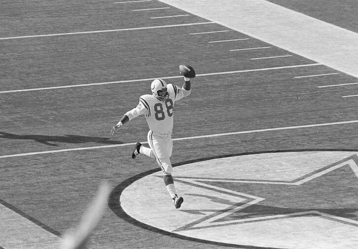 Tight end John Mackey of the Baltimore Colts charges out of the end zone holding the ball high after scoring the Colt's first touchdown against the Dallas Cowboys during Super Bowl V in Miami, Fla., Jan. 17, 1971. Mackey got the ball when a pass was tipped into his hands. (AP Photo/Harold Valentine)