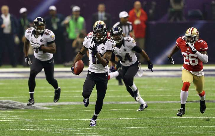 NEW ORLEANS, LA - FEBRUARY 03:  Jacoby Jones #12 of the Baltimore Ravens returns a kick-off 108-yards for a touchdown to open up the second half against Tramaine Brock #26 of the San Francisco 49ers during Super Bowl XLVII at the Mercedes-Benz Superdome on February 3, 2013 in New Orleans, Louisiana. The Ravens won 34-31. (Photo by Al Bello/Getty Images)